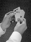 Male Hands Holding Hand Poker Cards 4 Aces and a King