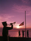1960s Boy Scout Blowing Bugle as Others Raise American Flag at Camp Sunset Ceremony