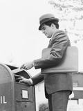 Young Businessman with Briefcase Dropping Letter into Mailbox