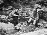 Couple Having Picnic Sitting on Rocks