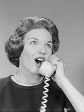 Excited Woman Talking on Telephone