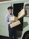 Delivery Truck Driver Holding Packages