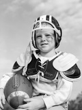 1960s Boy in Football Helmet and Pads Holding Ball Smiling Outdoor