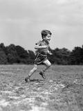 1940s Little Boy Running Playing on Grassy Field