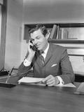 Businessman Executive at Desk Talking on Telephone