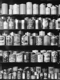 1930s-1940s Tin Cans and Containers on Shelves