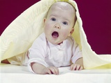 1960s Baby Mouth Wide Open Peeking Out from under Yellow Blanket