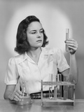 Young Woman Chemist Holding Up Test Tube
