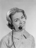 Smiling Woman Telephone Operator Wearing Headset