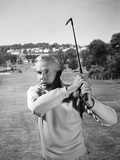 1960s Man Playing Golf Hitting Golf Ball from Fairway with Iron Club
