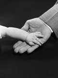 Man Hand Holding Supporting Baby Hand