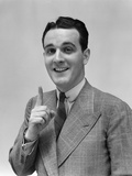 1940s Man in Suit Holding Up Index Finger Making a Point