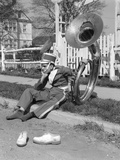 Teen Boy Band Uniform and Tuba Sitting on Curb with Shoes Off