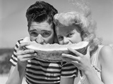 Teen Age Boy and Girl Eating Slice Watermelon