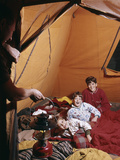 1960s Father with Lantern Checking Up on 3 Boys in Sleeping Bags Pajamas in Tent