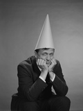 Man Wearing Dunce Cap