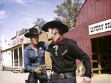 1960s Cowboy Sheriff with Badge Draws Gun Arrests Gunfighter in Front of Livery Stable