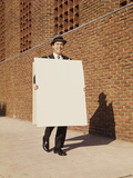 Smiling Man Wearing Suit Necktie and Hat Walking Carrying Large Sandwich Board