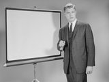 Man Standing Beside Blank Screen Ready for Presentation