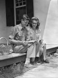 Man Woman Sitting on Porch of Farmhouse Reading Catalog