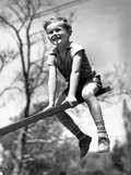 Boy on Seesaw Smiling