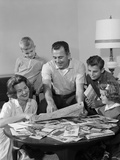 1960s Happy Family Father Mother Two Sons One Daughter Planning Trip Looking at Maps