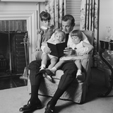 Man Father Sitting in Chair with Three Children Reading Book