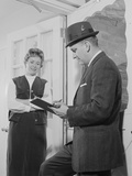 Man with Clipboard Talking to Woman in Doorway