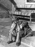 Little Girl Sitting on Porch Stoop Funny Expression Hands Up to Her Face Beside Her Dog