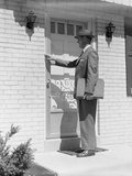 Salesman Wearing Suit Tie Hat Carrying Briefcase Ringing Suburban House Doorbell