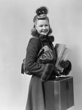 Smiling Young Blond Woman Wearing Hat Fur Trimmed Coat Carrying Packages
