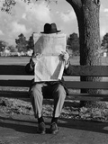 Humor Portrait Man Wearing Hat Sitting on Park Bench Reading Newspaper