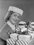Smiling Woman in Fur Hat Holding Wrapped Christmas Presents