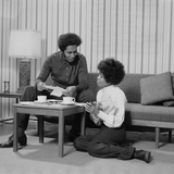 African American Couple Living Room Talking over Coffee
