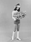 Young Woman Wearing Santa Claus Hat Hot Pants Go-Go Boots Holding Wrapped Christmas Presents
