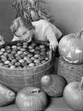 1950s Smiling Woman Leaning over Wooden Tub Filled with Water About to Begin Bobbing for Apples