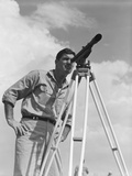 Man Using a Theodolite While Surveying