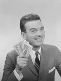Smiling Man Holding a Fistful of Money Fake Bills