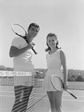 Portrait Tennis Couple Man Woman Holding Racquets Standing by Net