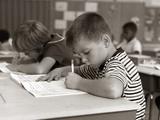 1960s Boy Striped T-Shirt Elementary School Classroom Sitting Desk Writing Test