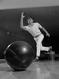 Young Man Having Just Thrown a Bowling Ball