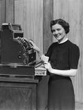 Smiling Sales Woman Ringing Up Sale on Cash Register