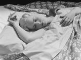 Sleeping Blond Woman Hand over Head Asleep