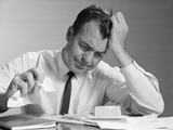 Frustrated Businessman Hand to Forehead Crumpling Paper in Hand