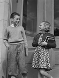 Smiling Boy and Girl Holding School Books