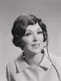 Smiling Brunette Woman Wearing Telephone Head Set
