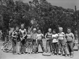 1950s Line-Up of 9 Boys in Tee Shirts with Bats and Mitts Facing Camera