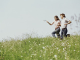 Young Teen Couple Boy Girl Running Field Wildflowers