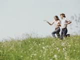 Young Teen Couple Boy Girl Running Field Wildflowers