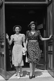 Two Smiling Women Walking Out Doorway of a Store